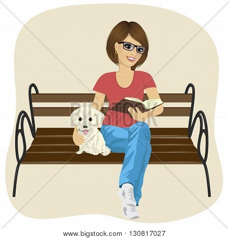 Young happy woman enjoying freetime outside reading a book sitting on a bench hugging labrador puppy
