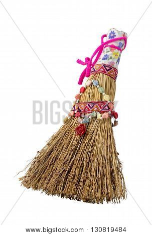 Small ornate broom made of straw isolated on white