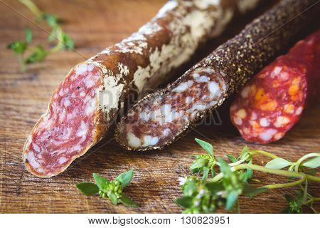 Three types of spanish sausages black, red and white on wooden board. Traditional spanish appetizer tapas