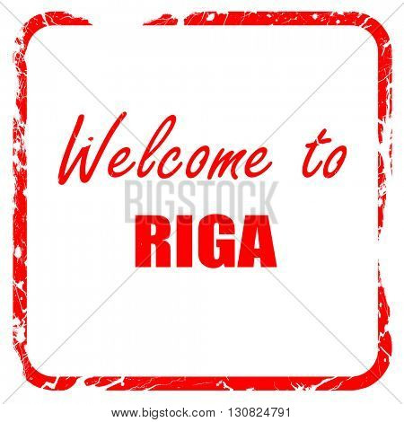 Welcome to riga, red rubber stamp with grunge edges