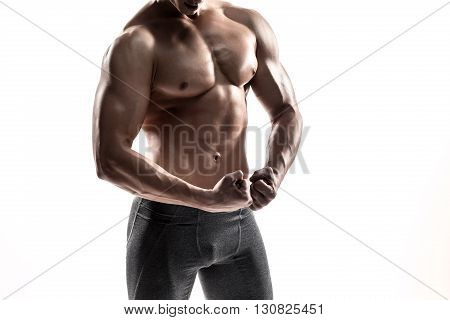Close-up strong bodybuilder man posing with perfect abs, houlders, biceps, triceps and chest. Isolated on white background