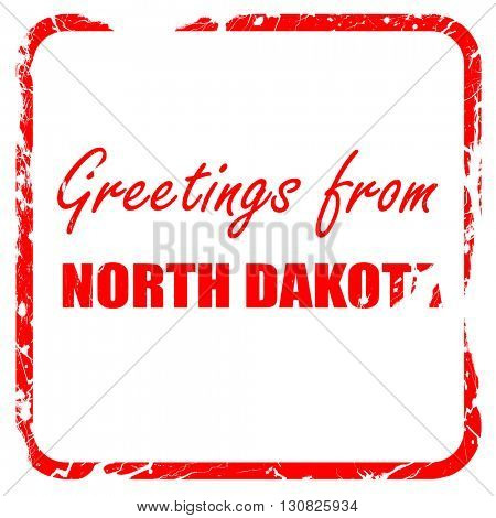 Greetings from north dakota, red rubber stamp with grunge edges