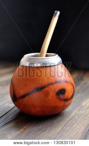 Calabash with bombilla on a wooden table