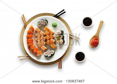 Japanese food restaurant, salmon sushi gunkan roll plate or platter set. Set for five with chopsticks, ginger, soy sauce and wasabi. Sushi isolated at white background. Top view, Flat lay