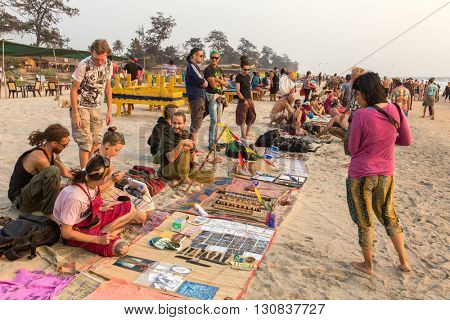 Goa, India - February 15, 2016: Flea market in Arambol. The set hand-made souvenirs can be bought after sunset.