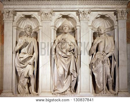 LUCCA, ITALY - JUNE 06, 2015: Altar of St. Regulus (Saints John the Baptist, Regulus and Sebastian) in the Cathedral of St Martin in Lucca, Italy, on June 06, 2015