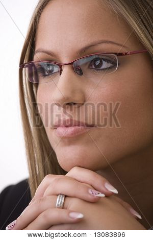 Portrait of young attractive businesswoman wearing glasses, thinking.