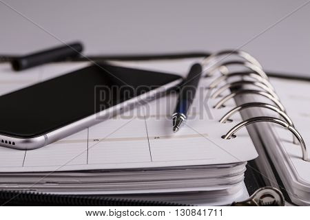 plan your future and business - calendar planner cellphone and pen