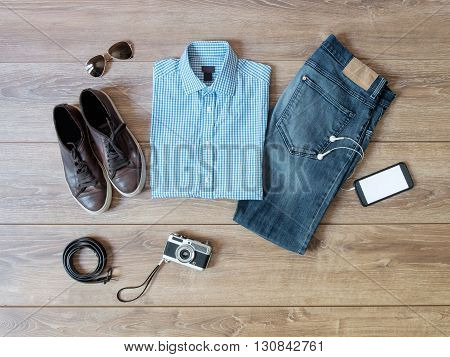 top view of casual clothes isolated on wooden background