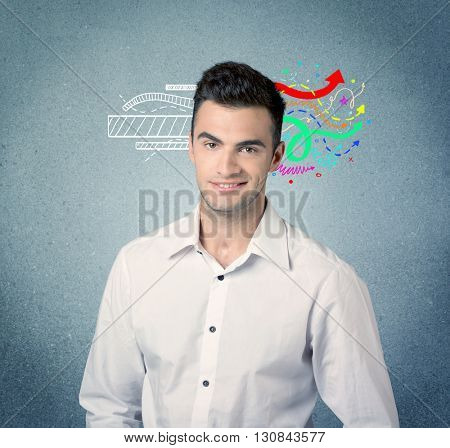 A handsome sales person standing in front of a blue  urban concrete wall with illustration expressing creativity by transforming white lines to colorful arrows cocncept