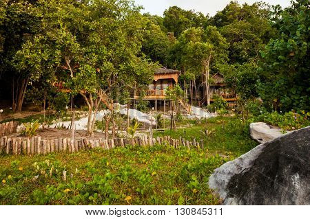Summer on tropical island Koh Rong in Cambodia. Landscape of south east Asia with local houses.
