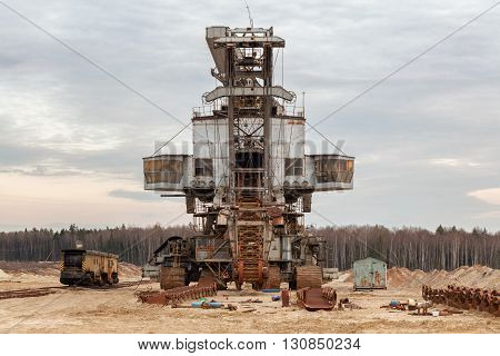 Many buckets of giant quarry excavator Equipment for the extraction of sand from the quarry. Front view