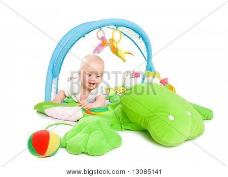 Happy Baby spielen in Baby-Gym-Toy, isolated on white Background.