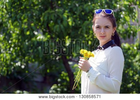 woman with dandelion in the park. close up
