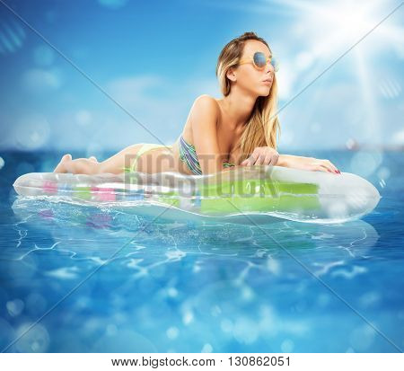 Sunbathe on an airbed in the sea