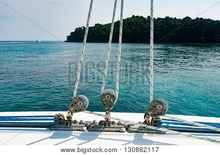 Small winches with rope on the deck of luxury yacht