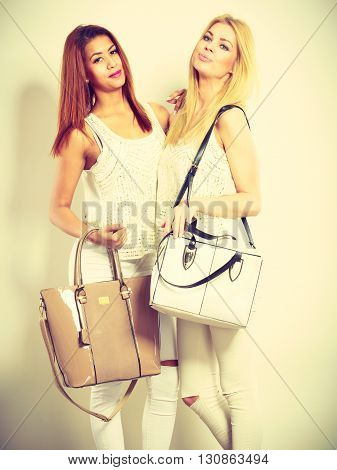 Nice Female Friends With Handbags.