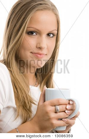 Closeup protrait of beautiful college girl drinking coffee, holding a cup. Isolated on white background.