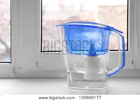 Water filter jug on the windowsill