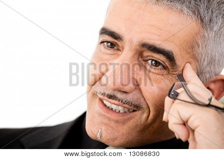 Mature gray haired creative looking businessman thinking, isolated on white background.