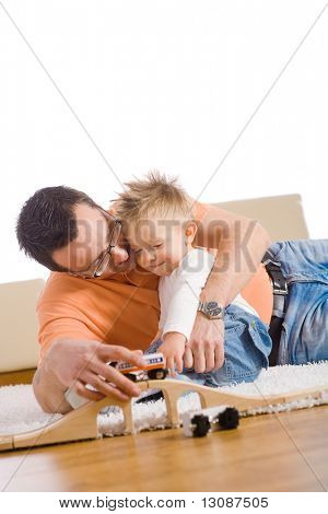 Father and kid having fun together at home.
