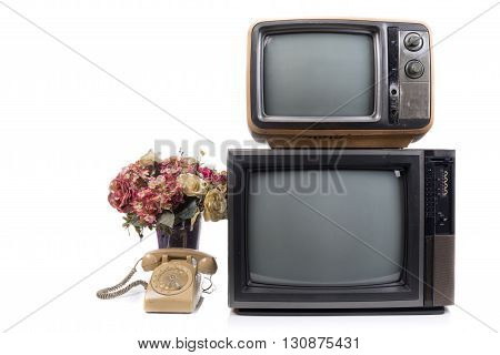 Vintage Television and telephone with flower on white background