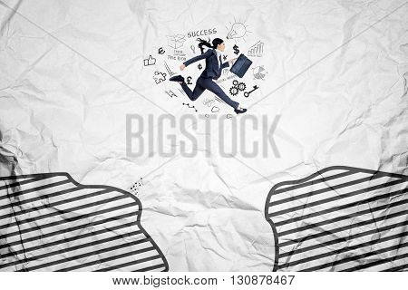 Young female entrepreneur jumping above a cliff while carrying a briefcase with business doodles and crumpled background