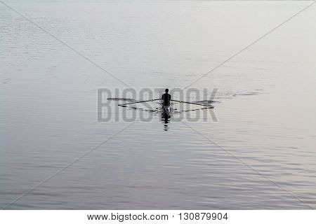 Single oarsman in kayak rowing in Ottawa river,Canada.