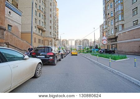 Moscow, Russia - May, 11, 2016:  cars on a parking in an inhabited district in Moscow, Russia