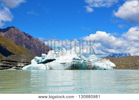 Iceberg (broken free from a glacier) floating in an alpine lake