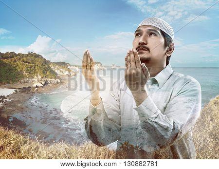 Image Of Multi Exposure Man Praying