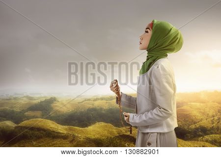 Young Muslim Woman Holding Prayer Beads