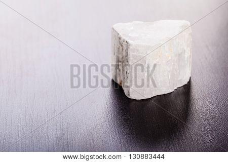 Selenite Stone On Wood
