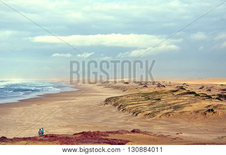 Rough seas and windy weather on a beach and nearby sand dunes