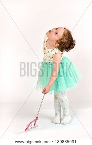 Fashion little girl in green dress in catwalk model pose stock photo. Image 04