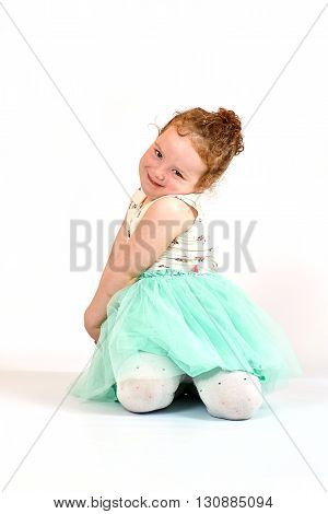 Fashion little girl in green dress in catwalk model pose stock photo. Image 06