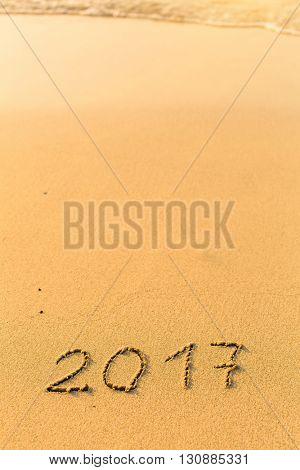 2017 - written by hand on a golden beach sand.