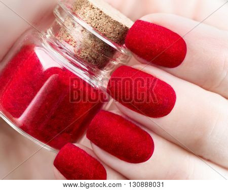 Velvet nails. Fashion trendy red fluffy nail art design closeup. Beauty hands. Stylish Nailpolish