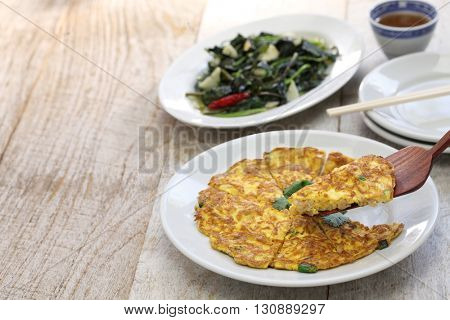 taiwanese cuisine, dried radish omelet, stir fried sweet potato leaves