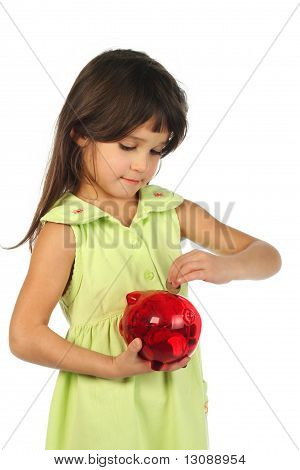 Little girl with red piggy bank