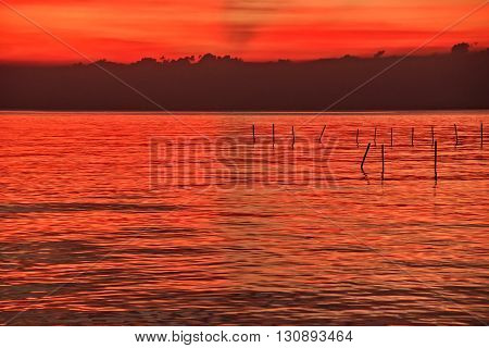 red twilight sky and beautiful seascape colorful cloudscape background landscape