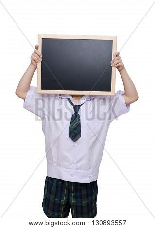 Student in uniform holding chalkboard over white