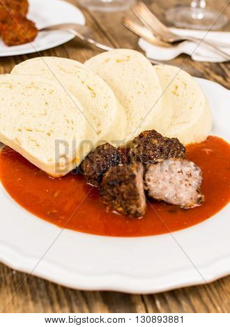 Czech traditional cuisine tomato soup with dumpling and meatball