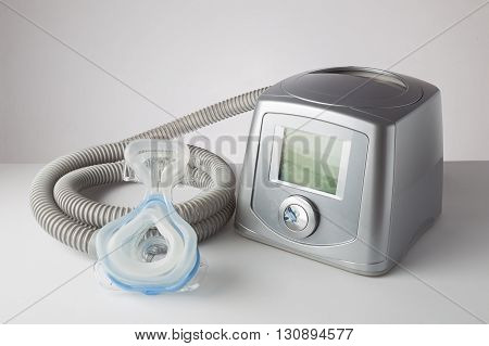 CPAP machine with mask and hose for people with sleep apnea respiratory or breathing disorder