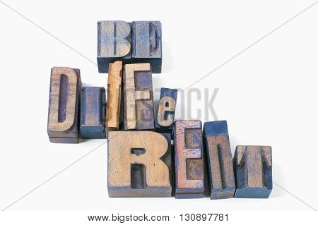 be different phrase made from scattered wooden letterpress type isolated on white