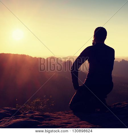 Hiker Take Relaxing On A Rock And Enjoying Sunset At Horizon. Vivid Effect.