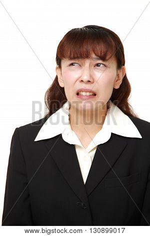 portrait of perplexed businesswoman on white background