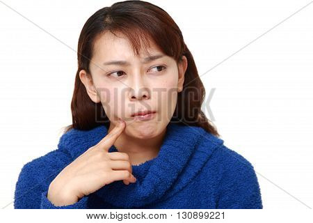 portrait of Asian woman worries about something on white background