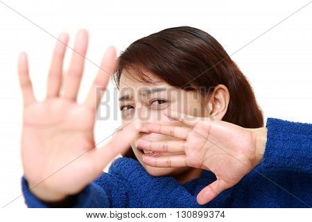 portrait of Asian businesswoman making stop gesture on white background
