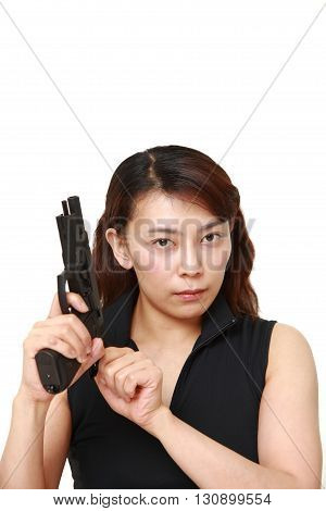 studio shot of a woman with a handgun